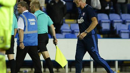 Mick McCarthy has his say with the departing team of officials after the late loss at Reading