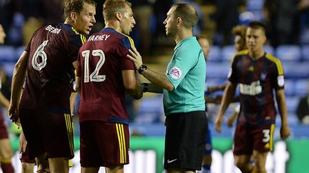 Luke Varney and Christophe Berra have words with the referee after the final whistle at Reading