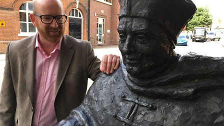 Philip Roberts in Ipswich, with the statue of Cardinal Wolsey. Wolsey saw Whitehall palace transform
