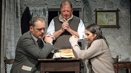 Simon Stanhope, left, as Richard Hannay, along with Amy Christina Murray and Clive Flint as crofters