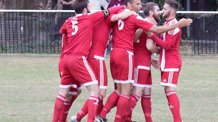 Felixstowe players congratulate Craig Jennings (2nd right) on his goal