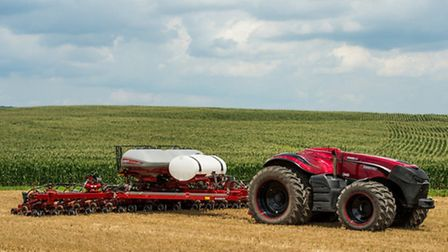 Case IH Magnum Autonomous Concept Tractor in the field with the Case IH Early Riser 2150 Planter.