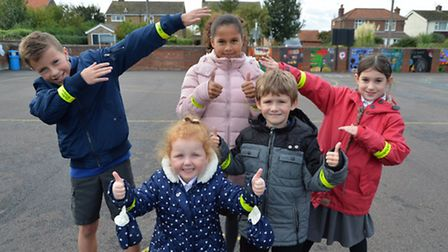 Youngsters at Trimley St Martin Primary School have been given hi-viz snap bands by developer Taylor