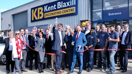 Neil Ogilvie, chief executive of the Painting and Decorating Association, cutting the ribbon to open