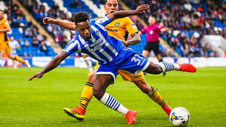 Colchester's Tarique Fosu loses the battle to stay on his feet in this duel for the ball with Newpor