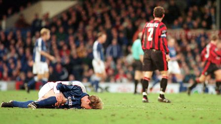 Gary Croft clutches his leg after being brought down during Town's match against Huddersfield in 199