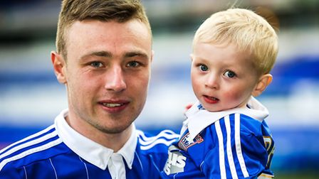 Freddie Sears and son Jax pictured on the pitch after the Ipswich Town v Milton Keynes Dons (Champio