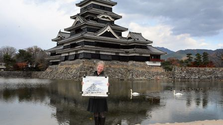 Mary-Anne Bartlett holding painting of Matsumoto castle.