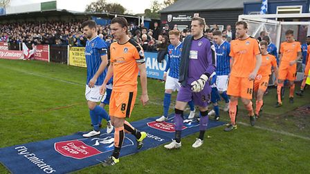 Players are led out by the Royal British Legion before the start of the U's FA Cup first round tie a
