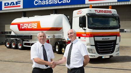 Tim King, group fleet manager at Turners (Soham), left, takes delivery of the firm's newest truck fr