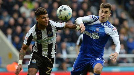 Tom Lawrence tussles with Deandre Yedlin at Newcastle