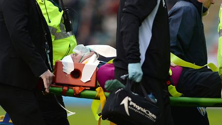 The referee Kevin Johnson is stretchered off after a collision with a Plymouth player during the U's