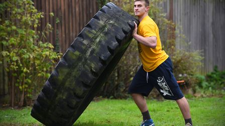 Allen training with a tyre at home in Trimley