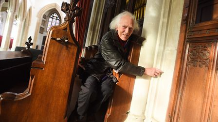 Roger Green with new 'graffiti' in St Peter's Church, Sudbury.