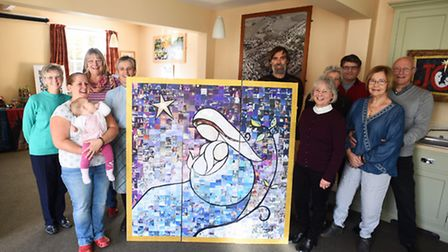 Folk involved with Grundisburgh Cribfest, with the Madonna and Child mosaic - made from recycled Chr