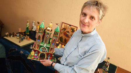 The Rev Clare Sanders with some of the pieces in her collection of cribs and nativity scenes