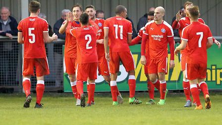 Leiston's players celebrate Jack Ainsley's winner at Chippenham, in the FA Trophy.