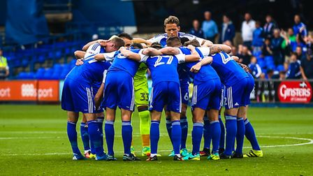 Ipswich players in a huddle ahead of the Ipswich Town v Aston Villa (Championship) match at Portman