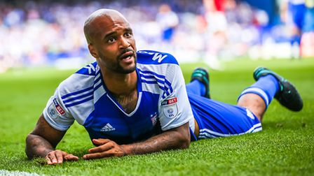 David McGoldrick looks towards the linesman after he ended up on the turf folloing a challenge from