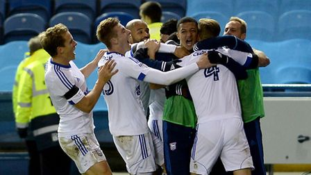 Luke Chambers is mobbed after scoring the winner at Hillsborough
