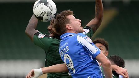 Chris Porter battles for a high ball at Home Park against Plymouth on Saturday