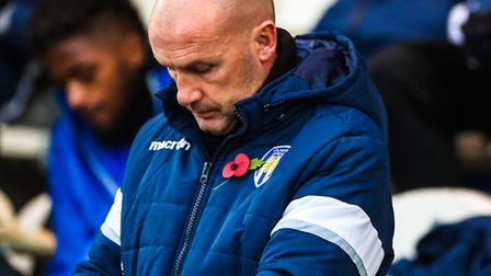 U's manager John McGreal looks at his watch during this afternoon's 3-0 home defeat to Leyton Orient