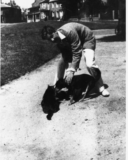 George Orwell and the Blair family dog, Hector, and cat, in Southwold. Photo: The Orwell Archive, UC