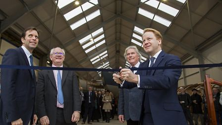Ipswich MP Ben Gummer, right, performs the official opening ceremony at a new boat building facility