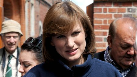 Antiques Roadshow presenter Fiona Bruce talking to production staff during the filming of the popula