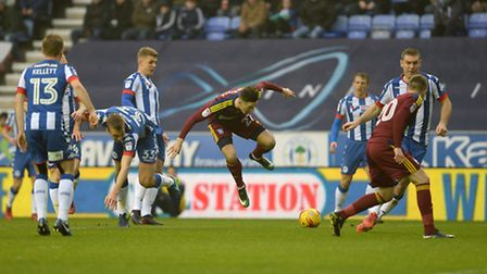 Tom Lawrence collides with Wigan defender Dan Burn which gives Ipswich a fortuitous penalty during t