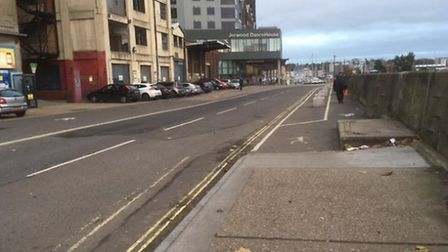 The area of footpath, road and parking space from Stoke Bridge towards Dance East. Now the surface