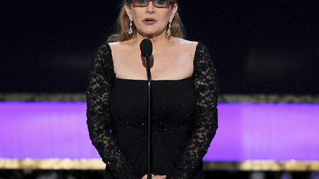 Carrie Fisher presents the life achievement award on stage at the 21st annual Screen Actors Guild Aw