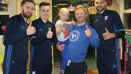 Ipswich Town footballer Cole Skuse, Tom Lawrence and Bart Bialkowski with Russell Turner and his son