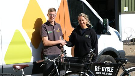 Paul Mead of Muntons handing its 'site bikes' to Charlotte Ward of Re-cycle for shipment to Africa.