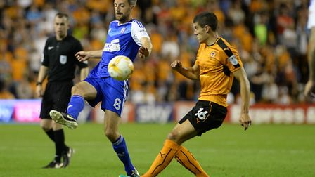 Cole Skuse beats Conor Coady to the ball at Wolves