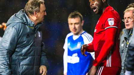 Cardiff City manager Neil Warnock and Sol Bamba argue on the touchline after the latter had been sen