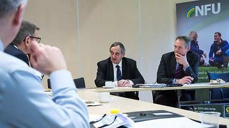 National Farmers' Union president Meurig Raymond, centre, leads a meeting urging banks to back farm