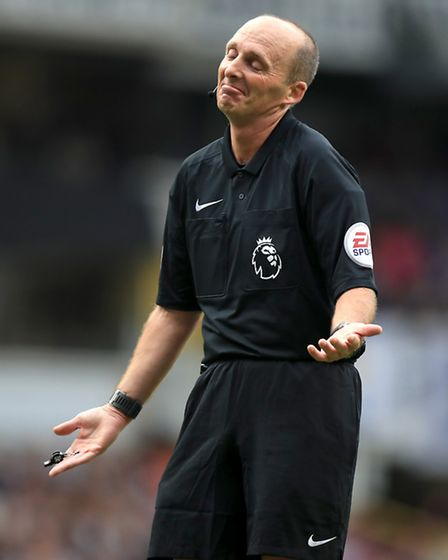 Match referee Mike Dean during the Premier League match at White Hart Lane, London. Photo: PA Wire/M