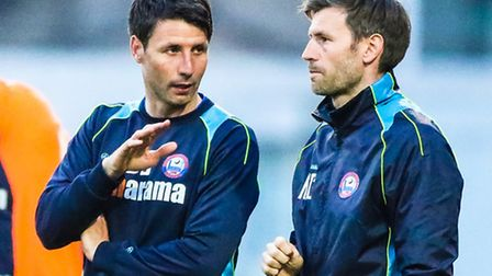 Former Braintree manager Dan Cowley (left) discusses tactics with his brother and assistant Nicky.