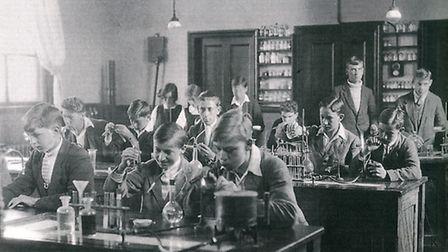 Chemistry at the Sir John Leman School. Dorothy and her friend Norah can just be seen in the back ro