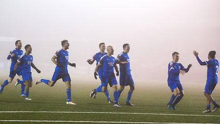 Leiston players rush towards Ollie Brown (right) after his penalty won the tie for Leiston. www.step