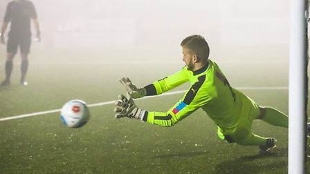 Jacob Marsden makes a fine save in the penalty shoot out.