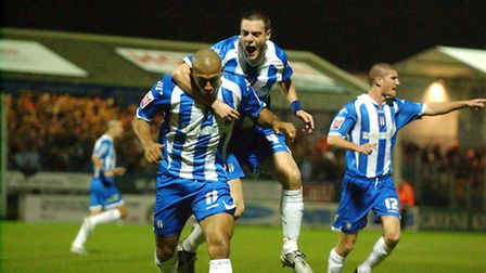chris iwelumo is mobbed after equalising against hull last night Colchester United v Hull Footb