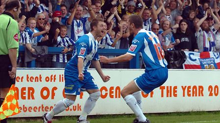 Jamie Cureton celebrates scoring the second goal of his hat-trick against Derby County
