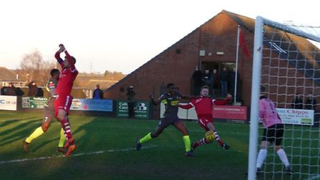 Sam Nunn scoring the opening goal for Needham Market V Staines. Picture: David Mayhew