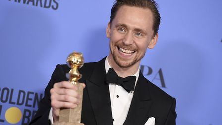 Tom Hiddleston with the award for best performance by an actor in a limited series or a motion pictu