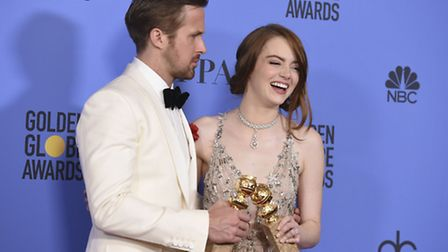 Ryan Gosling, left, and Emma Stone with the award for best performance by an actor and actress in a