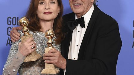 Isabelle Huppert, left, winner of the award for best performance by an actress in a motion picture -