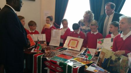 The Kenyan High Commissioner hears from the pupils of St Gregory�s what they have learned about Keny