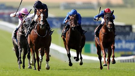 Racing at The Moet & Chandon July Festival at Newmarket Racecourse.
